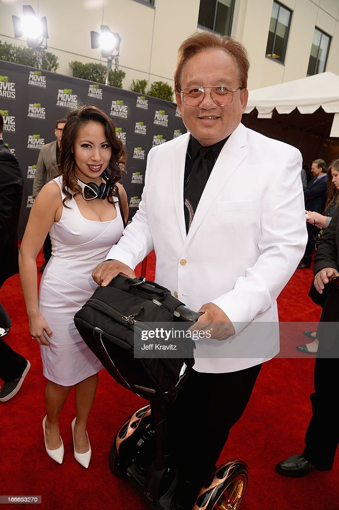 Monster Cable CEO Noel Lee (L) and guest attend the 2013 MTV Movie Awards at Sony Pictures Studios on April 14, 2013 in Culver City, California.