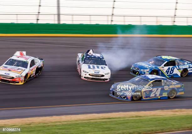 Monster Energy Cup driver Brad Keselowski and NASCAR Monster Energy Cup driver Clint Bowyer cause a wreck during the Quaker State 400 on July 8 2017...