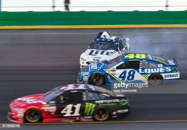 Monster Energy Cup driver Jimmie Johnson gets into NASCAR Monster Energy Cup driver Brad Keselowski as he spins during the Quaker State 400 on July 8...