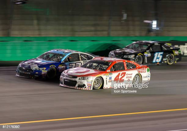 Monster Energy Cup driver Kyle Larson passes NASCAR Monster Energy Cup driver Matt DiBenedetto during the NASCAR Quaker State 400 Monster Energy Cup...