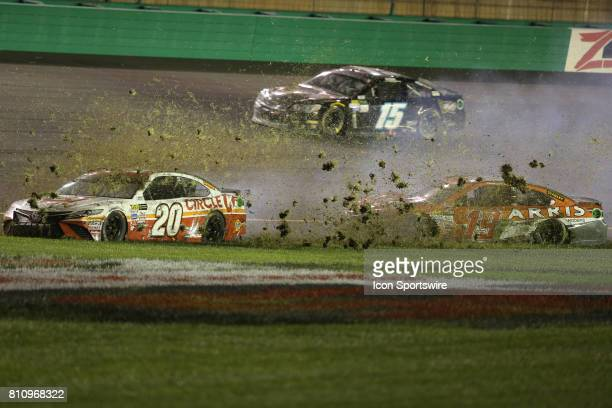 Monster Energy Cup driver Matt Kenseth and NASCAR Monster Energy Cup driver Daniel Suarez go into the grass after a multiple car collision at turn 4...