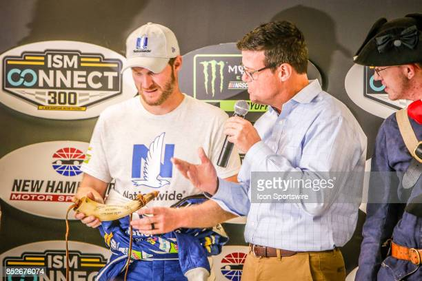 Monster Energy NASCAR Cup Series driver Dale Earnhardt Jr is presented with gift during press conference prior to qualifying for the NASCAR Monster...