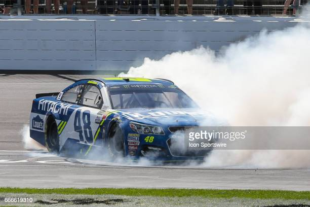 Monster Energy NASCAR Cup Series driver Jimmie Johnson celebrates with a burnout after winning the Monster Energy NASCAR Cup Series O'Reilly Auto...