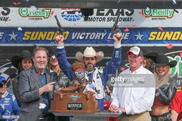 Monster Energy NASCAR Cup Series driver Jimmie Johnson celebrates in victory lane after winning the Monster Energy NASCAR Cup Series O'Reilly Auto...