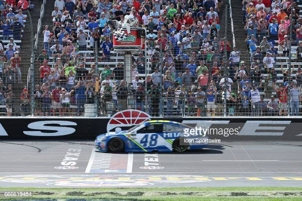 Monster Energy NASCAR Cup Series driver Jimmie Johnson crosses the finish line to win the Monster Energy NASCAR Cup Series O'Reilly Auto Parts 500 on...