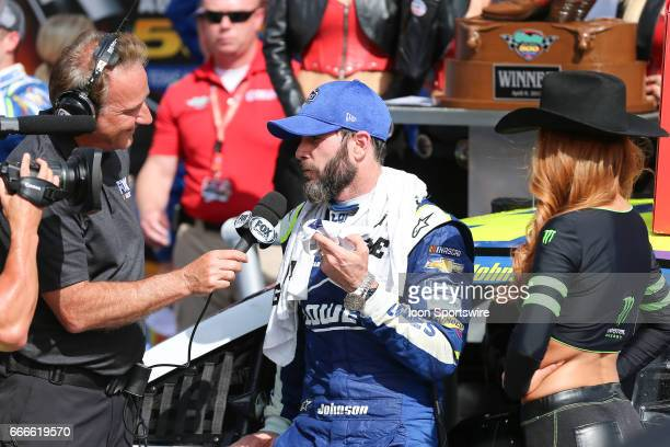 Monster Energy NASCAR Cup Series driver Jimmie Johnson does an interview after winning the Monster Energy NASCAR Cup Series O'Reilly Auto Parts 500...