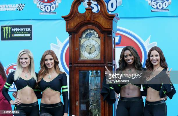 Monster Girls pose on stage in Victory Lane during the Monster Energy NASCAR Cup Series STP 500 at Martinsville Speedway on April 2 2017 in...