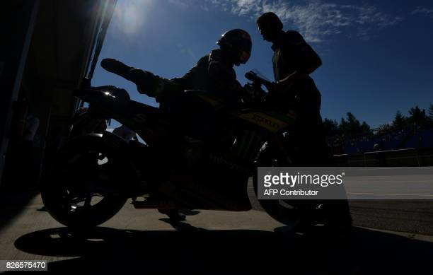 Monster Yamaha Tech 3 Team's French rider Johann Zarco leaves a paddock during a free practice session of the Moto GP Grand Prix of the Czech...