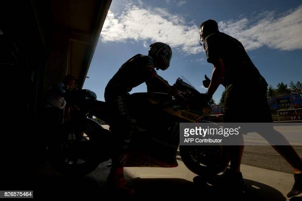Monster Yamaha Tech 3 Team's German rider Jonas Folger leaves a paddock during a free practice session of the Moto GP Grand Prix of the Czech...
