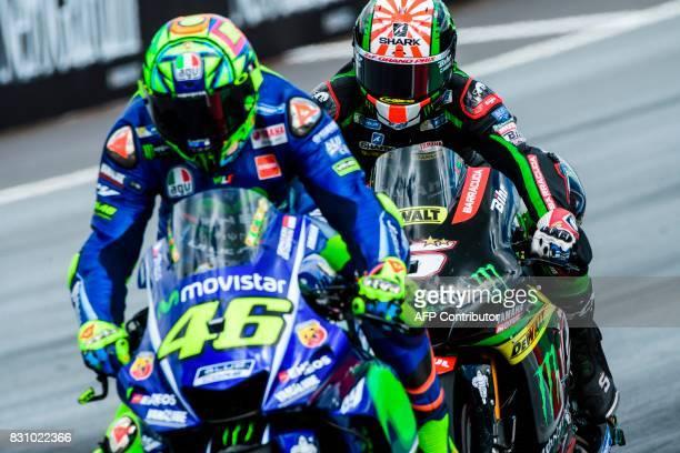 Monster Yamaha Tech 3's French rider Johann Zarco and Movistar Yamaha MotoGP's Italian rider Valentino Rossi compete during the MotoGP Austrian Grand...