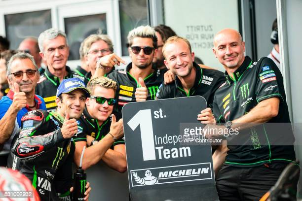 Monster Yamaha Tech 3's French rider Johann Zarco celebrates with his team after winning the Independent Team ranking and placing 5th overall at the...