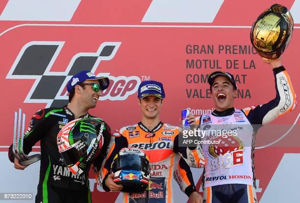 Monster Yamaha Tech 3's French rider Johann Zarco Repsol Honda Team's Spanish rider Dani Pedrosa and Repsol Honda Team's Spanish rider Marc Marquez...