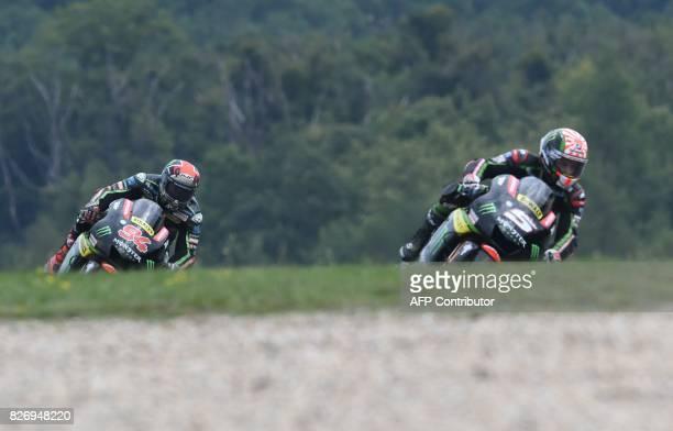 Monster Yamaha Tech3 team's German driver Jonas Folger and Monster Yamaha Tech3 team's French driver Johann Zarco compete during the MotoGP event of...