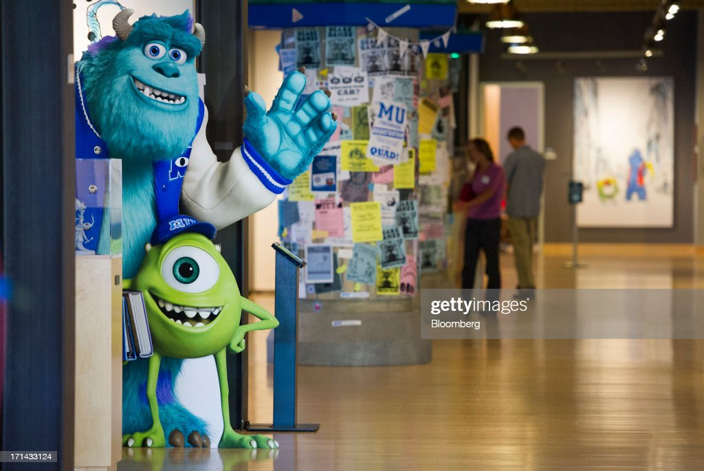 'Monsters University' character cut-outs stand as people walk in the halls at the Pixar Animation Studios headquarters in Emeryville, California, U.S., on Friday, June 21, 2013. Walt Disney Co.s Pixar animation 'Monsters University' took first place at U.S. and Canadian theaters this past weekend with $82 million in ticket sales, overcoming Brad Pitts zombie apocalypse tale 'World War Z,' which was second with $66 million. Photographer: David Paul Morris/Bloomberg via Getty Images