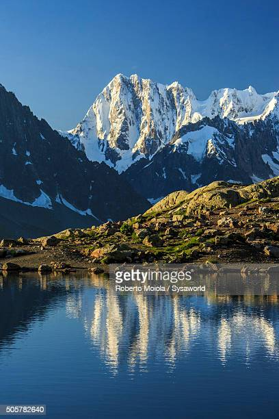 Mont Blanc and Dent Du Geant are reflected in Lac Blanc France