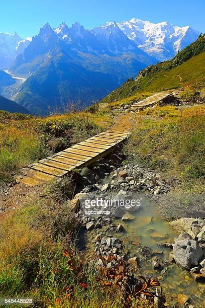 Mont Blanc idyllic alpine landscape, river – bridge path – Chamonix Alps