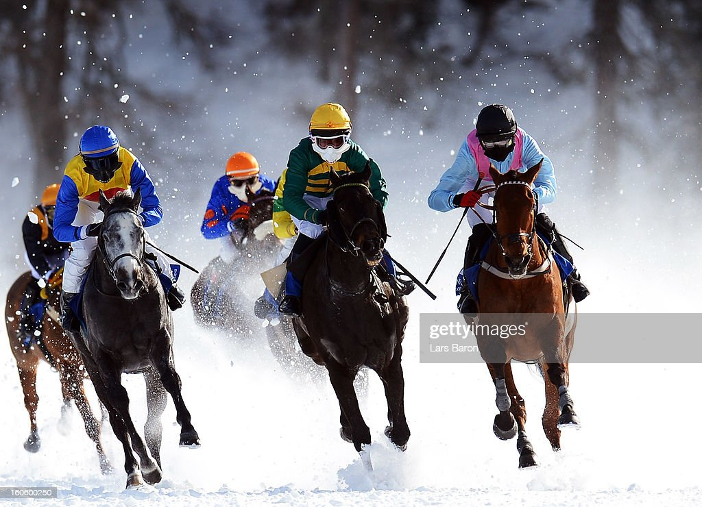 Mont Pelato ridden by Edouard Monfort (L) leads the field into the final turn during the Grand Prix American Airlines race at the White Turf horse racing meeting held on the frozen Lake St Moritz on February 3, 2013 in St Moritz, Switzerland.