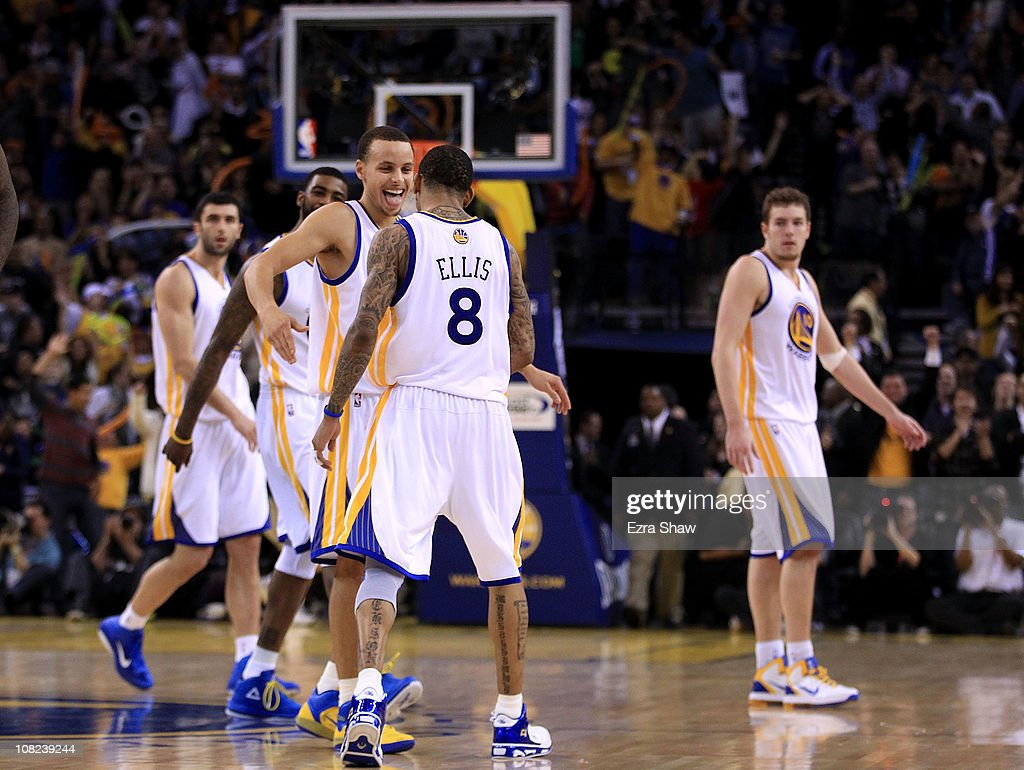 <a gi-track='captionPersonalityLinkClicked' href=/galleries/search?phrase=Monta+Ellis&family=editorial&specificpeople=567403 ng-click='$event.stopPropagation()'>Monta Ellis</a> #8 is congratulated by Stephen Curry #30 of the Golden State Warriors after Ellis made a shot with less than a second left in regulation to send their game against the Sacramento Kings into overtime at Oracle Arena on January 21, 2011 in Oakland, California.