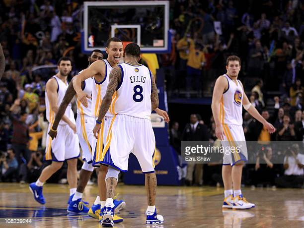 Monta Ellis is congratulated by Stephen Curry of the Golden State Warriors after Ellis made a shot with less than a second left in regulation to send...