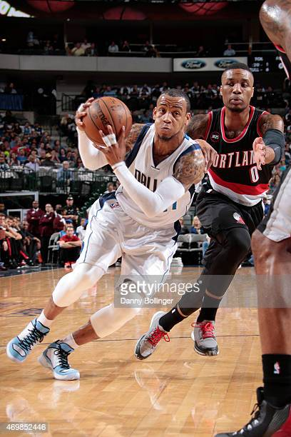 Monta Ellis of the Dallas Mavericks drives against Damian Lillard of the Portland Trail Blazers on April 15 2015 at the American Airlines Center in...