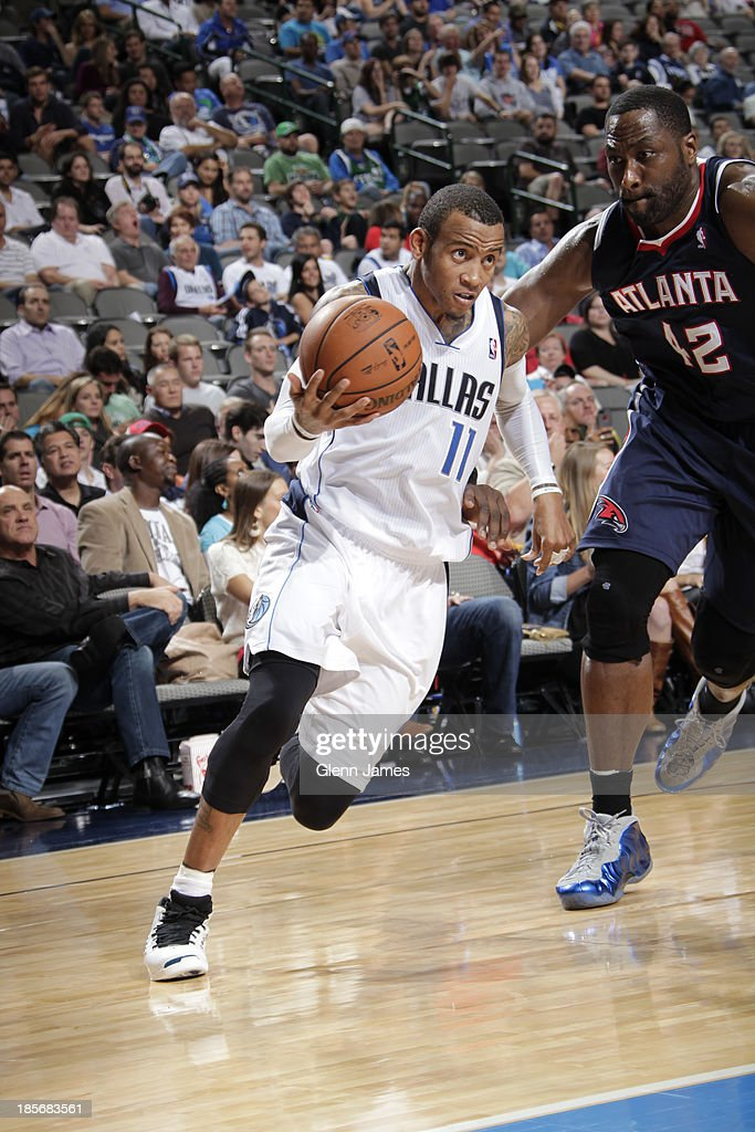 <a gi-track='captionPersonalityLinkClicked' href=/galleries/search?phrase=Monta+Ellis&family=editorial&specificpeople=567403 ng-click='$event.stopPropagation()'>Monta Ellis</a> #11 of the Dallas Mavericks drives against <a gi-track='captionPersonalityLinkClicked' href=/galleries/search?phrase=Elton+Brand&family=editorial&specificpeople=201501 ng-click='$event.stopPropagation()'>Elton Brand</a> #42 of the Atlanta Hawks on October 23, 2013 at the American Airlines Center in Dallas, Texas.