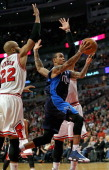 Monta Ellis of the Dallas Mavericks drives to the basket between Taj Gibson and Carlos Boozer of the Chicago Bulls at the United Center on December...