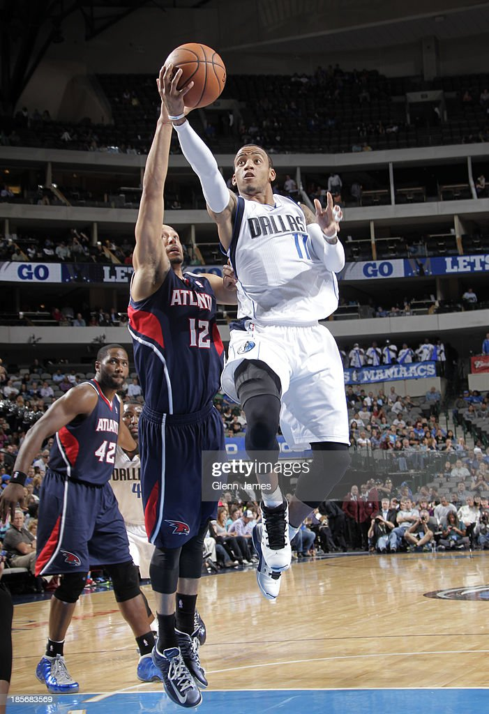 <a gi-track='captionPersonalityLinkClicked' href=/galleries/search?phrase=Monta+Ellis&family=editorial&specificpeople=567403 ng-click='$event.stopPropagation()'>Monta Ellis</a> #11 of the Dallas Mavericks goes in for the layup against John Jenkins #12 of the Atlanta Hawks on October 23, 2013 at the American Airlines Center in Dallas, Texas.