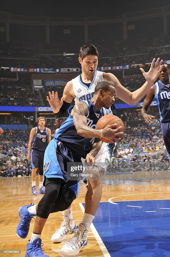 <a gi-track='captionPersonalityLinkClicked' href=/galleries/search?phrase=Monta+Ellis&family=editorial&specificpeople=567403 ng-click='$event.stopPropagation()'>Monta Ellis</a> #11 of the Dallas Mavericks handles the ball against Nikola Vucevic #9 of the Orlando Magic on November 16, 2013 at Amway Center in Orlando, Florida.