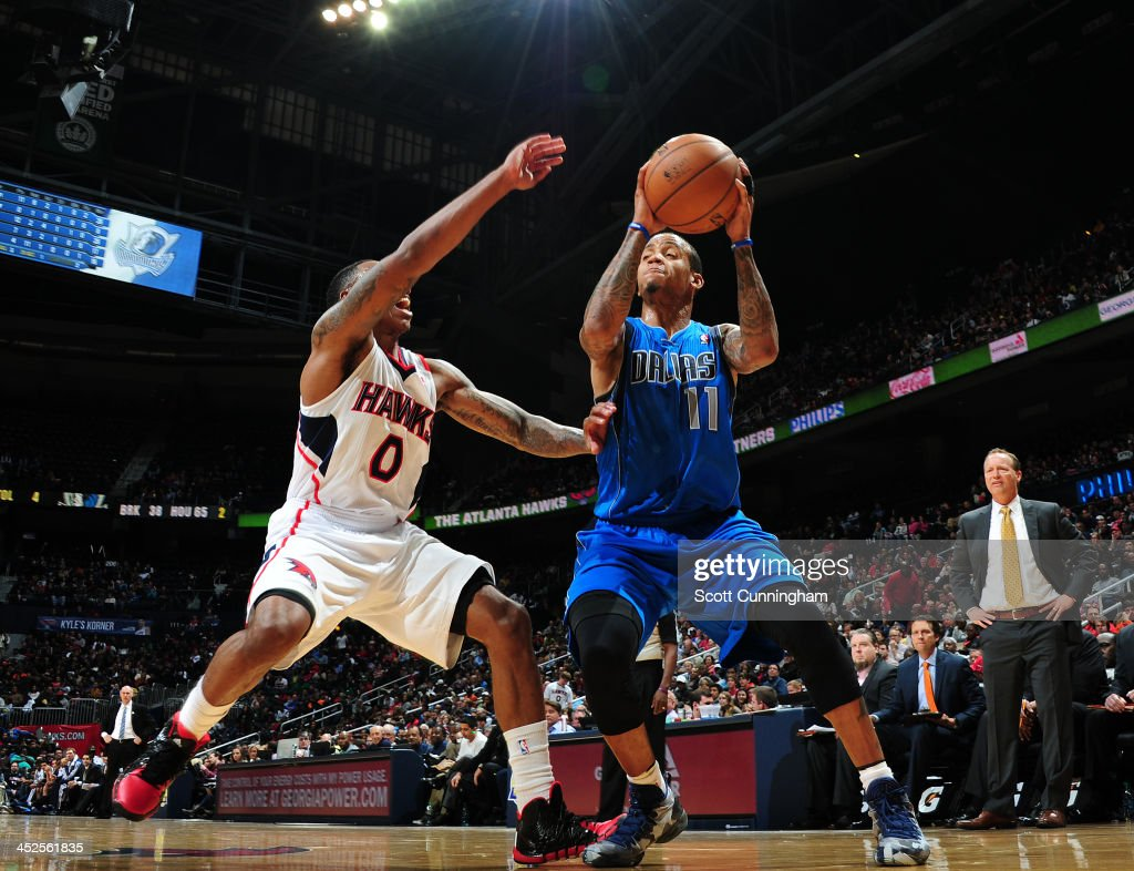 <a gi-track='captionPersonalityLinkClicked' href=/galleries/search?phrase=Monta+Ellis&family=editorial&specificpeople=567403 ng-click='$event.stopPropagation()'>Monta Ellis</a> #11 of the Dallas Mavericks handles the ball against the Atlanta Hawks on November 29, 2013 at Philips Arena in Atlanta, Georgia.