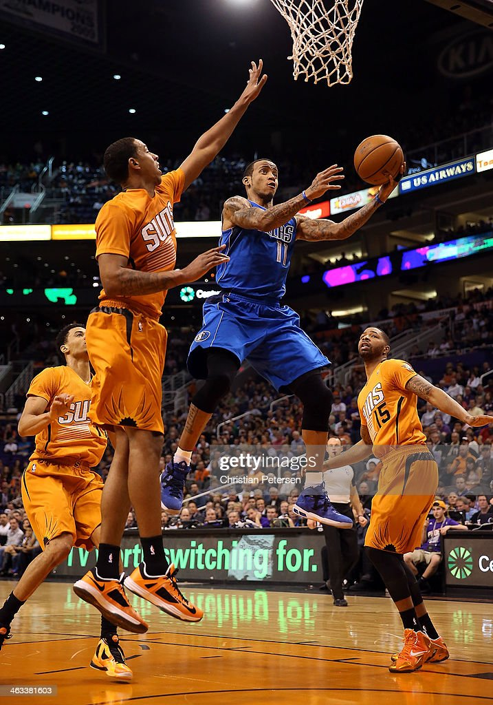 <a gi-track='captionPersonalityLinkClicked' href=/galleries/search?phrase=Monta+Ellis&family=editorial&specificpeople=567403 ng-click='$event.stopPropagation()'>Monta Ellis</a> #11 of the Dallas Mavericks lays up a shot past <a gi-track='captionPersonalityLinkClicked' href=/galleries/search?phrase=Channing+Frye&family=editorial&specificpeople=206815 ng-click='$event.stopPropagation()'>Channing Frye</a> #8 and Marcus Morris #15 of the Phoenix Suns during the first half of the NBA game at US Airways Center on January 17, 2014 in Phoenix, Arizona.