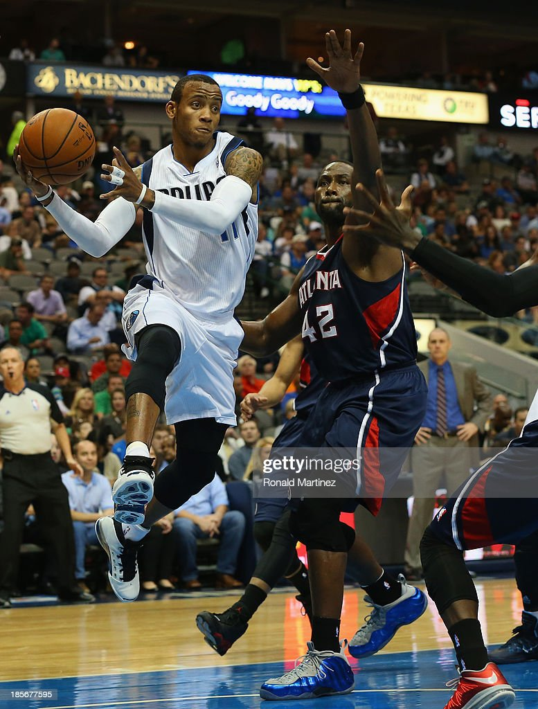 <a gi-track='captionPersonalityLinkClicked' href=/galleries/search?phrase=Monta+Ellis&family=editorial&specificpeople=567403 ng-click='$event.stopPropagation()'>Monta Ellis</a> #11 of the Dallas Mavericks pass the ball against <a gi-track='captionPersonalityLinkClicked' href=/galleries/search?phrase=Elton+Brand&family=editorial&specificpeople=201501 ng-click='$event.stopPropagation()'>Elton Brand</a> #42 of the Atlanta Hawks at American Airlines Center on October 23, 2013 in Dallas, Texas.