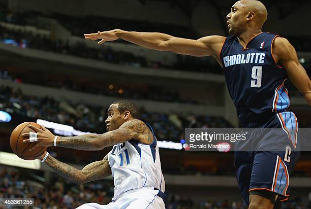 Monta Ellis of the Dallas Mavericks passes the ball against Gerald Henderson of the Charlotte Bobcats at American Airlines Center on December 3 2013...