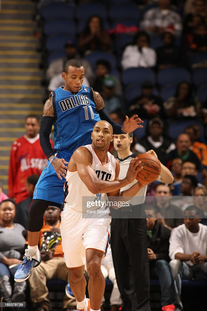 <a gi-track='captionPersonalityLinkClicked' href=/galleries/search?phrase=Monta+Ellis&family=editorial&specificpeople=567403 ng-click='$event.stopPropagation()'>Monta Ellis</a> #11 of the Dallas Mavericks plays tough defense against Gerald Henderson #9 of the Charlotte Bobcats at the Greensboro Coliseum on October 19, 2013 in Greensboro, North Carolina.