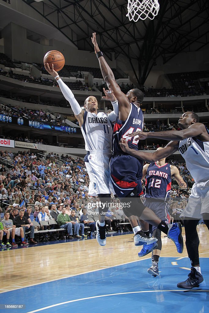 <a gi-track='captionPersonalityLinkClicked' href=/galleries/search?phrase=Monta+Ellis&family=editorial&specificpeople=567403 ng-click='$event.stopPropagation()'>Monta Ellis</a> #11 of the Dallas Mavericks shoots against <a gi-track='captionPersonalityLinkClicked' href=/galleries/search?phrase=Elton+Brand&family=editorial&specificpeople=201501 ng-click='$event.stopPropagation()'>Elton Brand</a> #42 of the Atlanta Hawks on October 23, 2013 at the American Airlines Center in Dallas, Texas.
