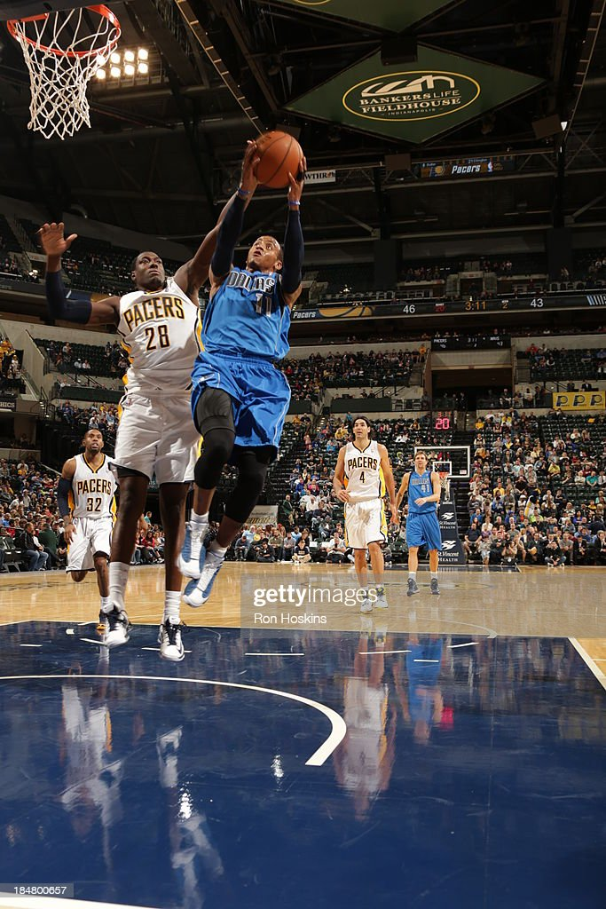 <a gi-track='captionPersonalityLinkClicked' href=/galleries/search?phrase=Monta+Ellis&family=editorial&specificpeople=567403 ng-click='$event.stopPropagation()'>Monta Ellis</a> #11 of the Dallas Mavericks shoots against <a gi-track='captionPersonalityLinkClicked' href=/galleries/search?phrase=Ian+Mahinmi&family=editorial&specificpeople=740196 ng-click='$event.stopPropagation()'>Ian Mahinmi</a> #28 of the Indiana Pacers at Bankers Life Fieldhouse on October 16, 2013 in Indianapolis, Indiana.
