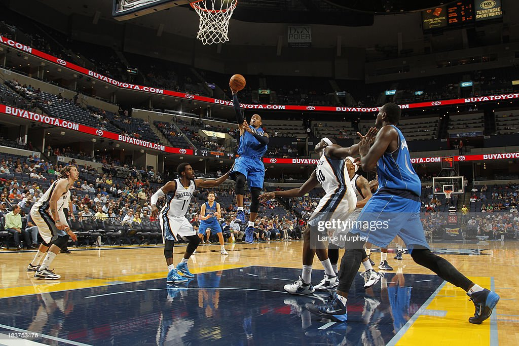 <a gi-track='captionPersonalityLinkClicked' href=/galleries/search?phrase=Monta+Ellis&family=editorial&specificpeople=567403 ng-click='$event.stopPropagation()'>Monta Ellis</a> #11 of the Dallas Mavericks shoots against Mike Conley #11 of the Memphis Grizzlies during a game on October 9, 2013 at FedExForum in Memphis, Tennessee.
