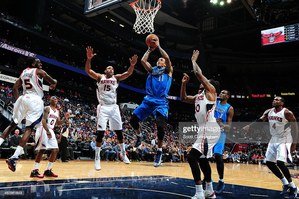 <a gi-track='captionPersonalityLinkClicked' href=/galleries/search?phrase=Monta+Ellis&family=editorial&specificpeople=567403 ng-click='$event.stopPropagation()'>Monta Ellis</a> #11 of the Dallas Mavericks shoots against the Atlanta Hawks on November 29, 2013 at Philips Arena in Atlanta, Georgia.