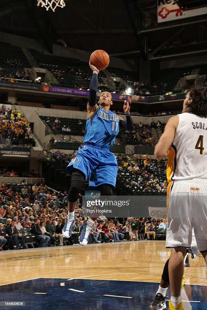 <a gi-track='captionPersonalityLinkClicked' href=/galleries/search?phrase=Monta+Ellis&family=editorial&specificpeople=567403 ng-click='$event.stopPropagation()'>Monta Ellis</a> #11 of the Dallas Mavericks shoots against the Indiana Pacers at Bankers Life Fieldhouse on October 16, 2013 in Indianapolis, Indiana.