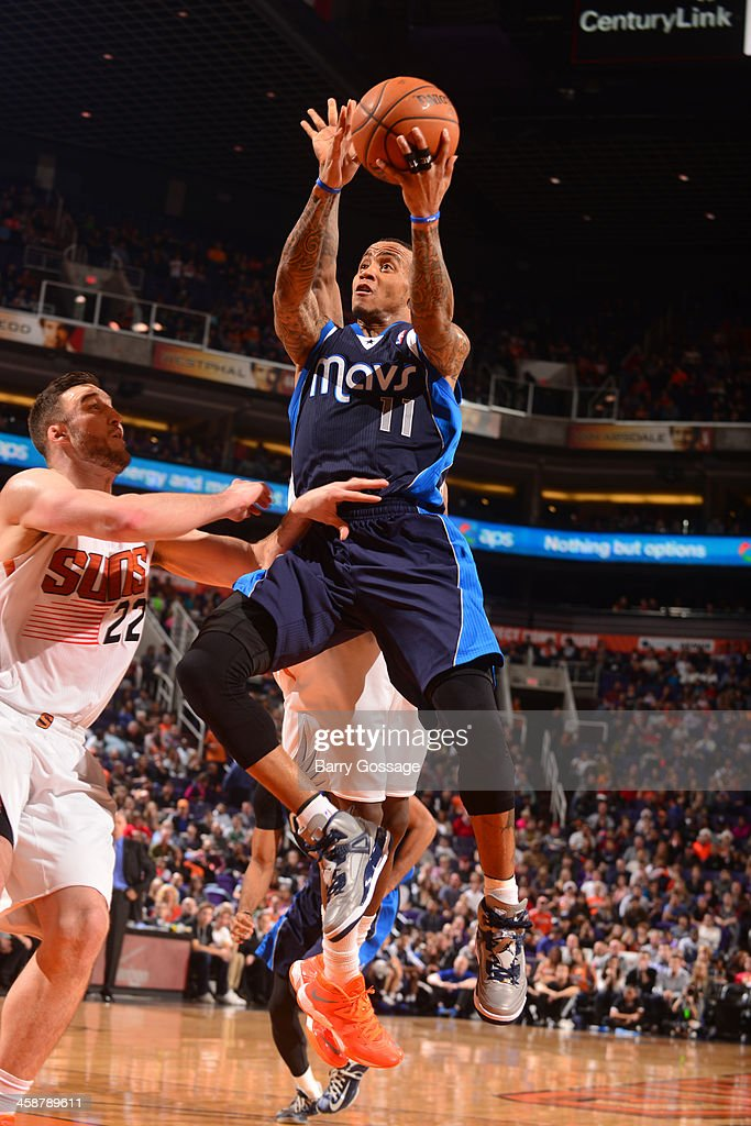 <a gi-track='captionPersonalityLinkClicked' href=/galleries/search?phrase=Monta+Ellis&family=editorial&specificpeople=567403 ng-click='$event.stopPropagation()'>Monta Ellis</a> #11 of the Dallas Mavericks shoots against the Phoenix Suns on December 21, 2013 at U.S. Airways Center in Phoenix, Arizona.