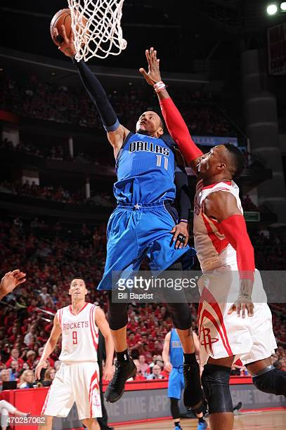 Monta Ellis of the Dallas Mavericks shoots the ball against Dwight Howard of the Houston Rockets in Game One of the Western Conference Quarterfinals...