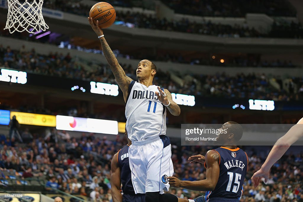 <a gi-track='captionPersonalityLinkClicked' href=/galleries/search?phrase=Monta+Ellis&family=editorial&specificpeople=567403 ng-click='$event.stopPropagation()'>Monta Ellis</a> #11 of the Dallas Mavericks takes a shot against <a gi-track='captionPersonalityLinkClicked' href=/galleries/search?phrase=Kemba+Walker&family=editorial&specificpeople=5042442 ng-click='$event.stopPropagation()'>Kemba Walker</a> #15 of the Charlotte Bobcats at American Airlines Center on December 3, 2013 in Dallas, Texas.