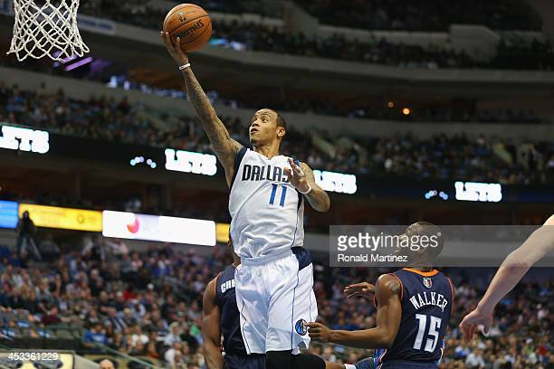 Monta Ellis of the Dallas Mavericks takes a shot against Kemba Walker of the Charlotte Bobcats at American Airlines Center on December 3 2013 in...