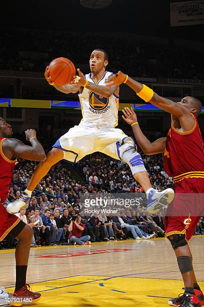 Monta Ellis of the Golden State Warriors attempts to flip the ball in against the Cleveland Cavaliers on January 7 2011 at Oracle Arena in Oakland...