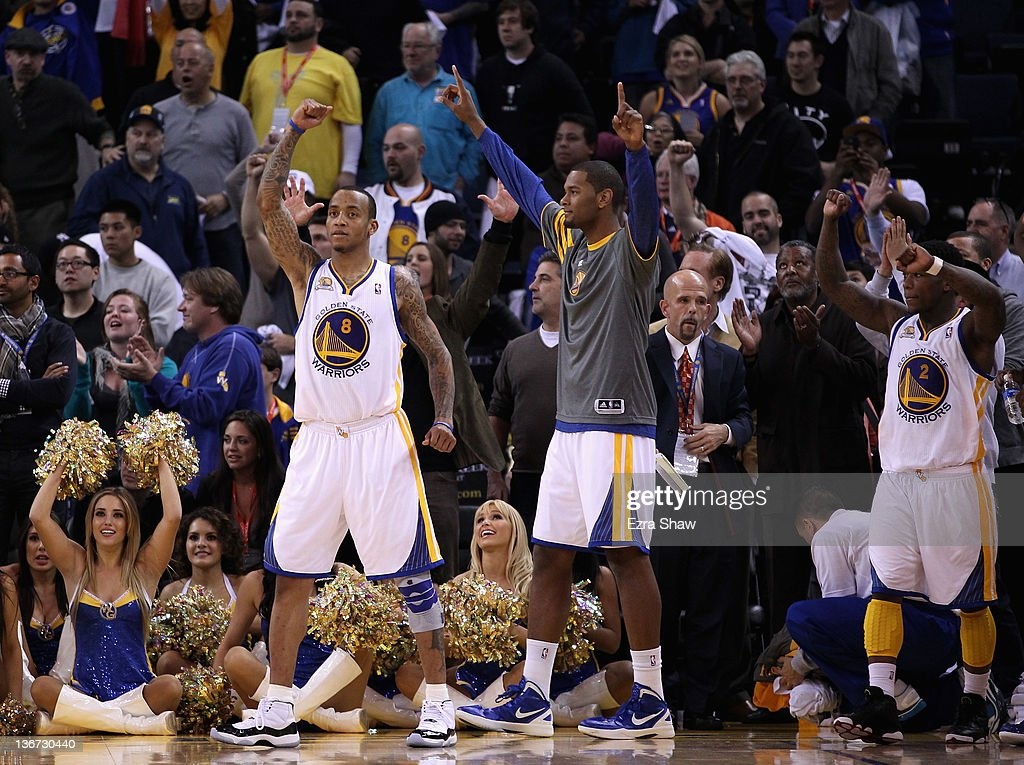 <a gi-track='captionPersonalityLinkClicked' href=/galleries/search?phrase=Monta+Ellis&family=editorial&specificpeople=567403 ng-click='$event.stopPropagation()'>Monta Ellis</a> #8 of the Golden State Warriors celebrates after they beat the Miami Heat at Oracle Arena on January 10, 2012 in Oakland, California.