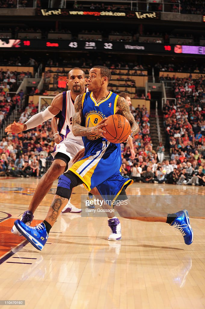 <a gi-track='captionPersonalityLinkClicked' href=/galleries/search?phrase=Monta+Ellis&family=editorial&specificpeople=567403 ng-click='$event.stopPropagation()'>Monta Ellis</a> #8 of the Golden State Warriors drives against <a gi-track='captionPersonalityLinkClicked' href=/galleries/search?phrase=Grant+Hill+-+Basketball+Player&family=editorial&specificpeople=201658 ng-click='$event.stopPropagation()'>Grant Hill</a> #33 of the Phoenix Suns in an NBA game played on March 18, 2011 at U.S. Airways Center in Phoenix, Arizona.