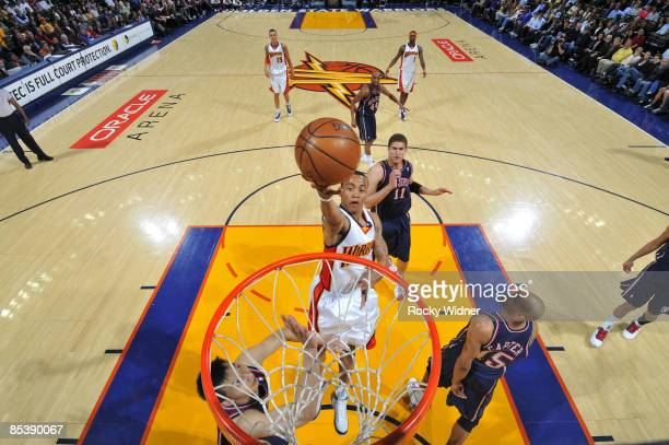 Monta Ellis of the Golden State Warriors drives for a layup against the New Jersey Nets on March 11 2009 at Oracle Arena in Oakland California NOTE...