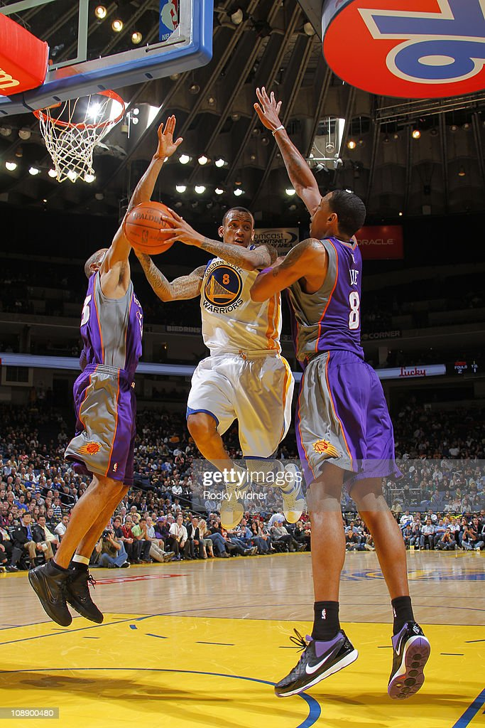 <a gi-track='captionPersonalityLinkClicked' href=/galleries/search?phrase=Monta+Ellis&family=editorial&specificpeople=567403 ng-click='$event.stopPropagation()'>Monta Ellis</a> #8 of the Golden State Warriors drives the ball through the defense of <a gi-track='captionPersonalityLinkClicked' href=/galleries/search?phrase=Channing+Frye&family=editorial&specificpeople=206815 ng-click='$event.stopPropagation()'>Channing Frye</a> #8 and <a gi-track='captionPersonalityLinkClicked' href=/galleries/search?phrase=Grant+Hill+-+Basketball+Player&family=editorial&specificpeople=201658 ng-click='$event.stopPropagation()'>Grant Hill</a> #33 of the Phoenix Suns on February 7, 2011 at Oracle Arena in Oakland, California.