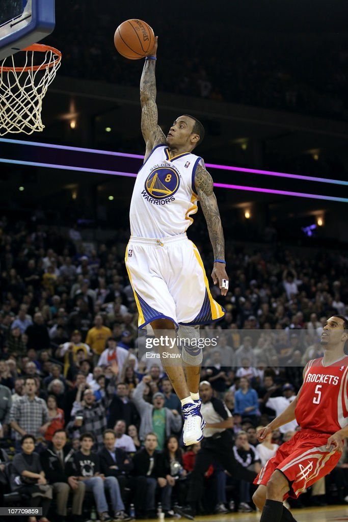 Monta Ellis #8 of the Golden State Warriors dunks the ball over Courtney Lee #5 of the Houston Rockets at Oracle Arena on December 20, 2010 in Oakland, California.