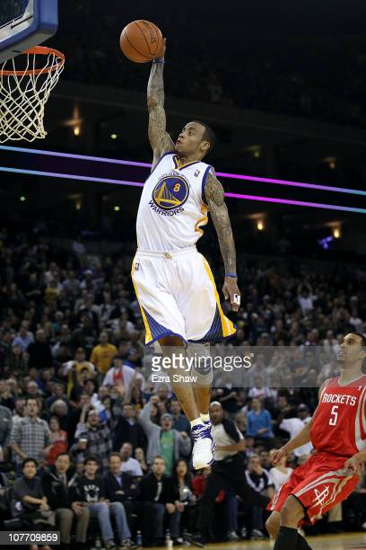Monta Ellis of the Golden State Warriors dunks the ball over Courtney Lee of the Houston Rockets at Oracle Arena on December 20 2010 in Oakland...