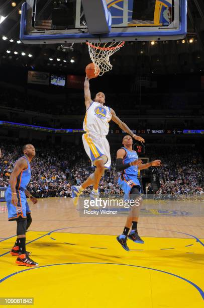 Monta Ellis of the Golden State Warriors goes coast to coast for the dunk against the Oklahoma City Thunder on February 13 2011 at Oracle Arena in...